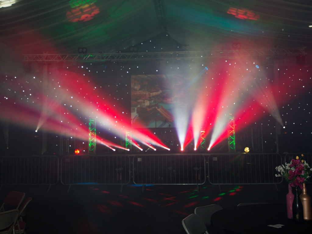 Lighting and star cloth backdrop for celebration event