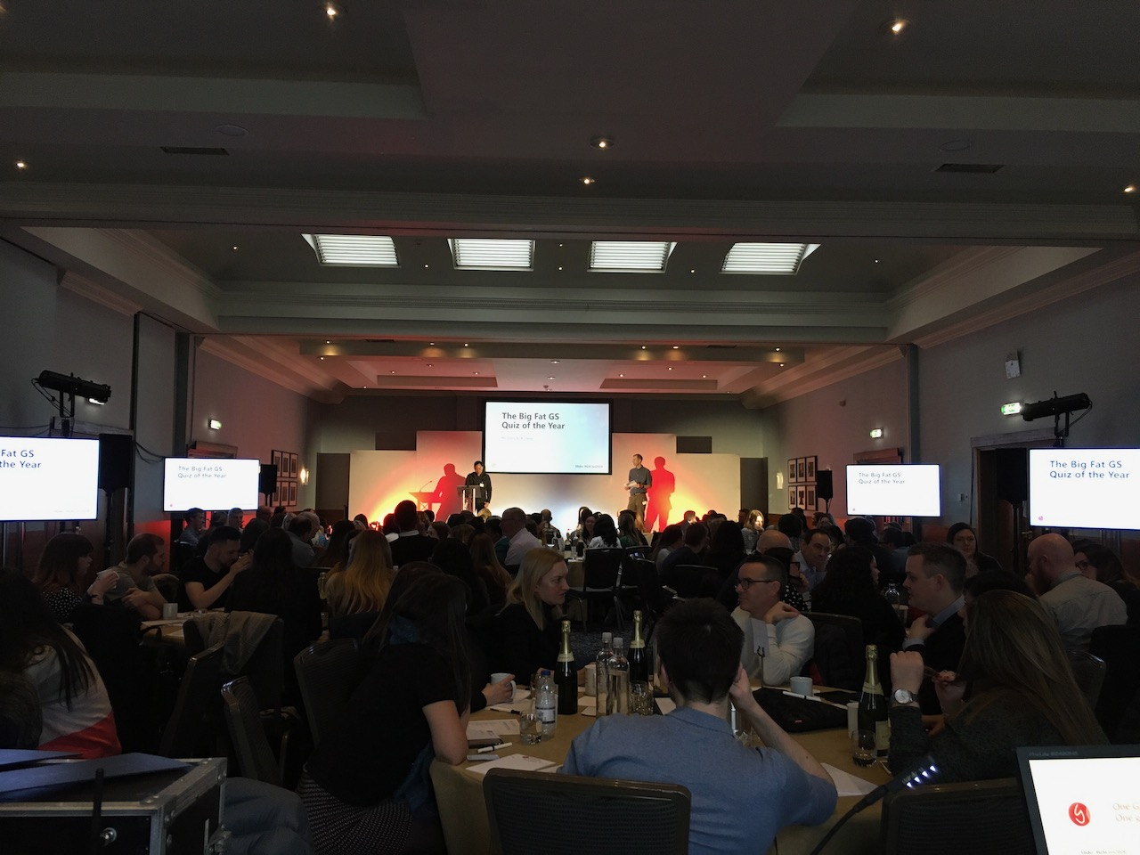 Conference screens with stage set, lighting and lectern
